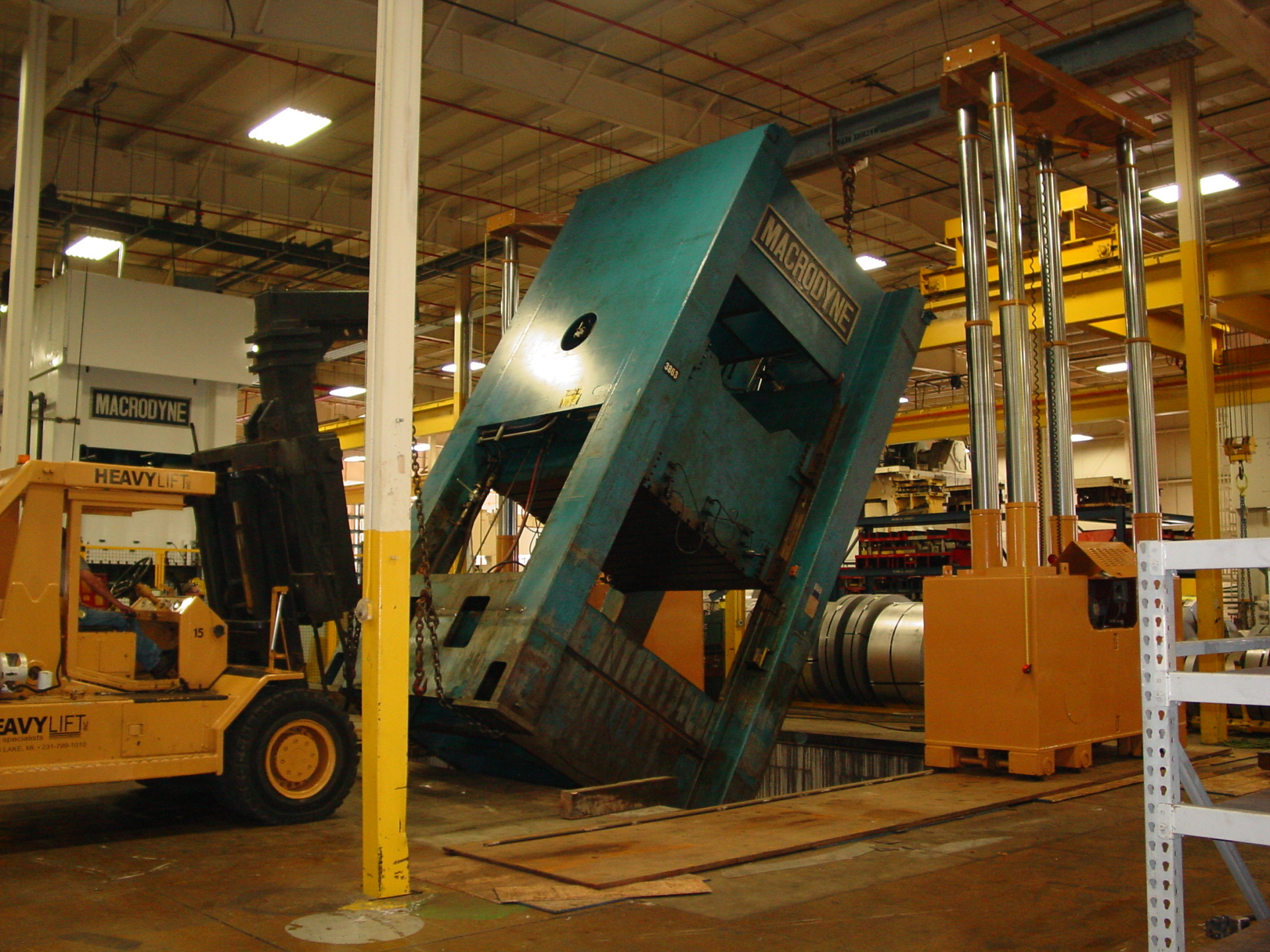 Using gantry and 40-ton forklift to stand up and place 150K Hydraulic Press.